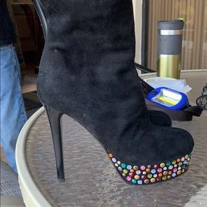 Black suede like new one of a kind boot,